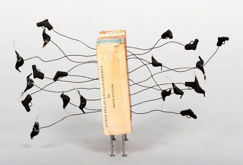 A Short History of the World by Lisa Kokin. Book fragments, wire, PVA glue, polymer clay, thread, nails, 6 x 8.5 x 7.5 inches, 2006