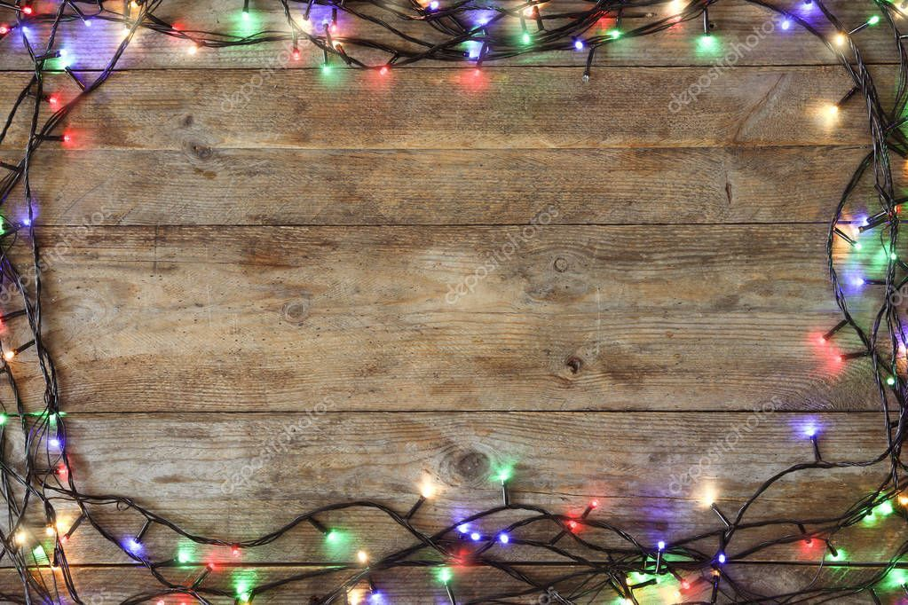 Frame Of Glowing Christmas Lights On Wooden Background Top View Space For Text Sponsored Lights Wooden Ch Christmas Lights Wooden Background Frame
