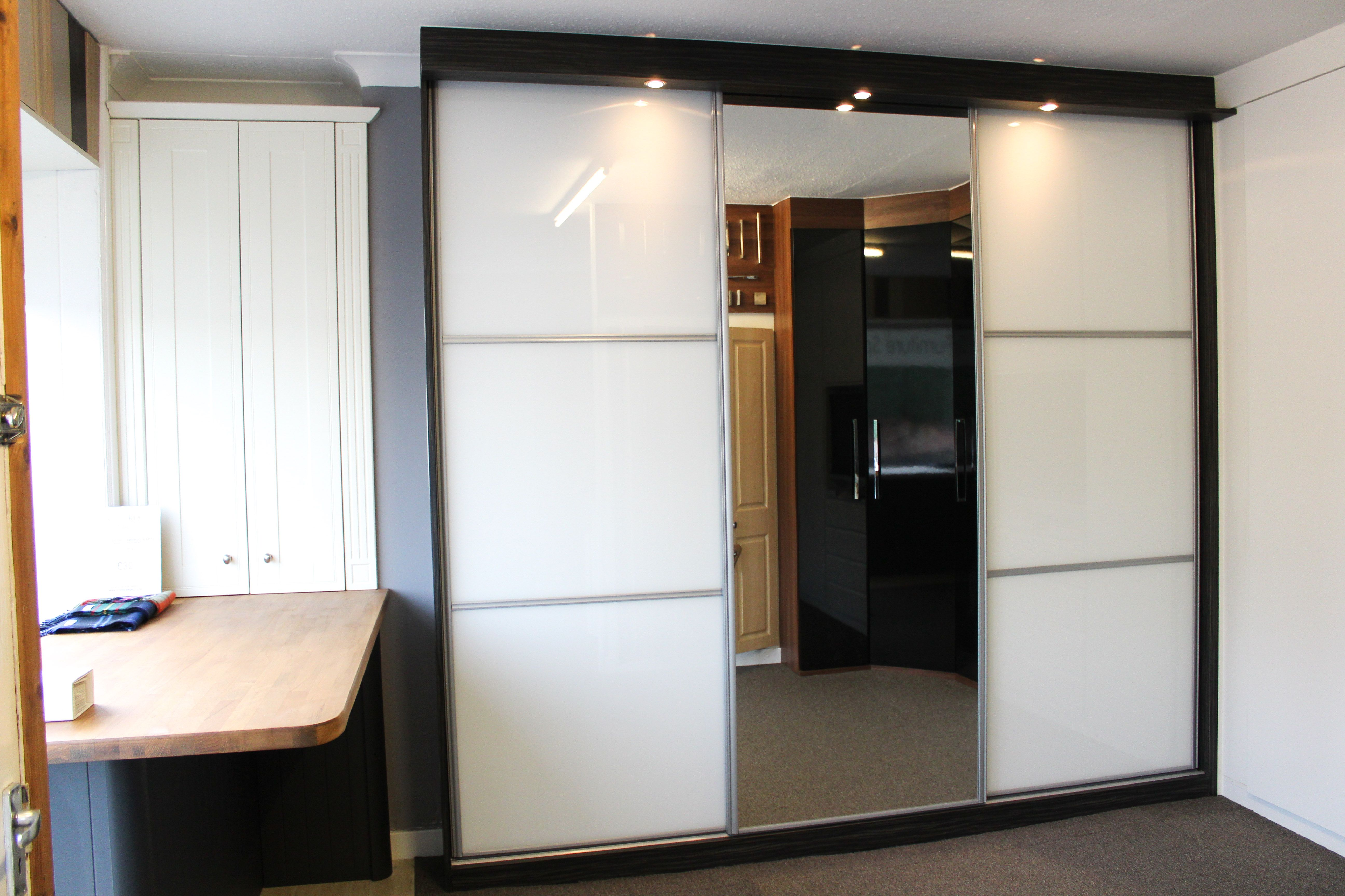 High Gloss White Sliding Doors Split Into 3 Pieces And A Full Mirror