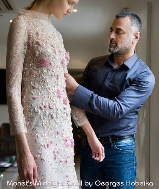 Georges Hobeika works on a couture gown from his Monet's Midnight Stroll Couture Collection