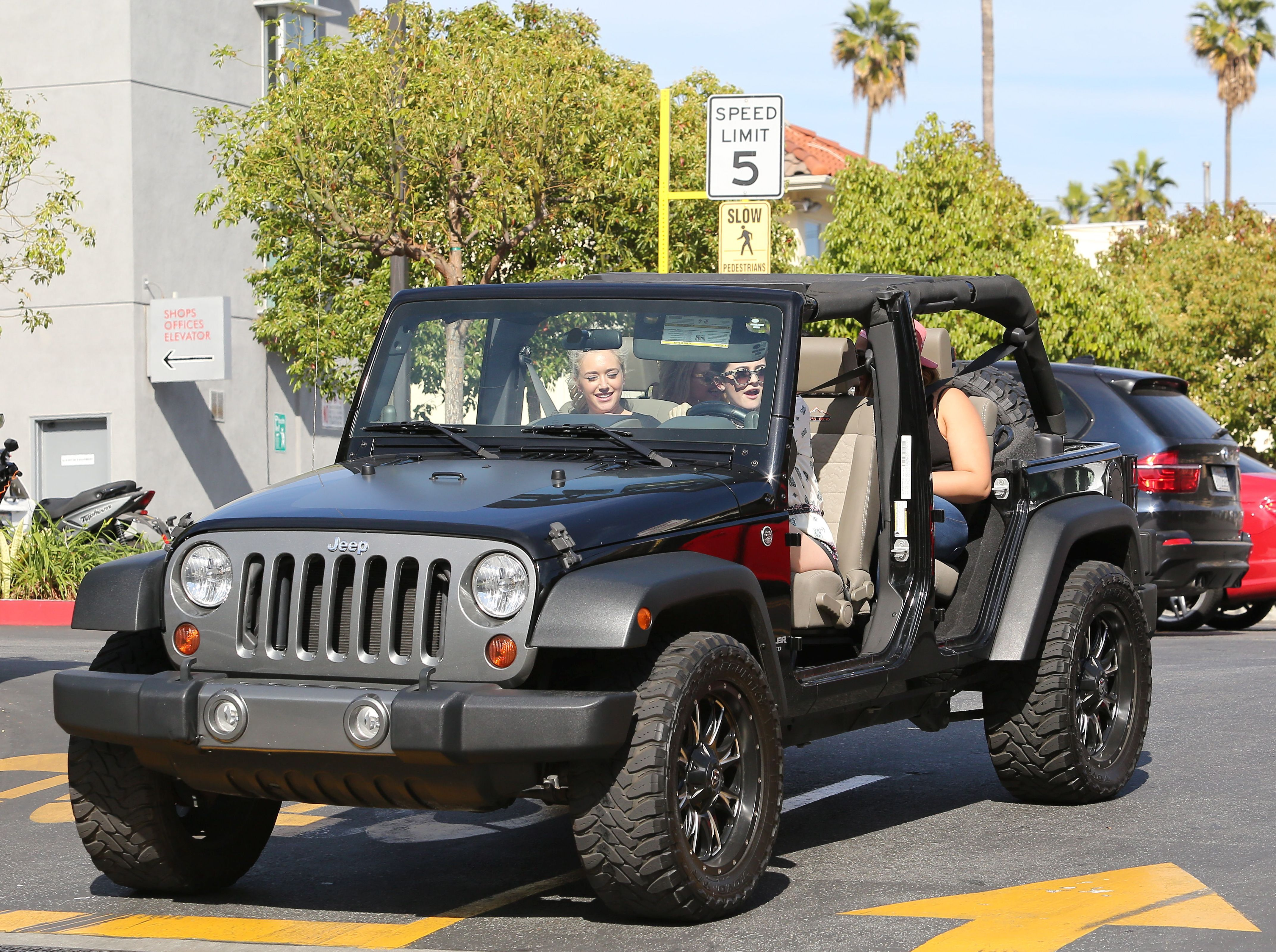 Kylie driving a jeep wrangler