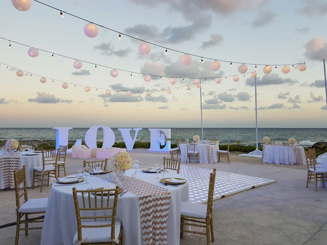 White and Gold accents and an Ocean View for this Wedding
