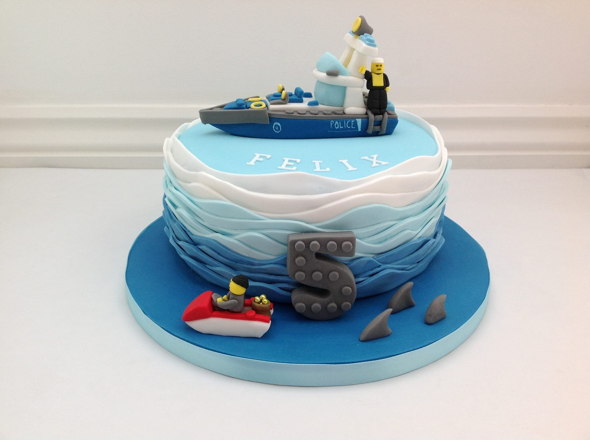 A Cops And Robbers Lego Birthday Cake With Blue Ombre Wave Effect - Lego birthday cake decorations