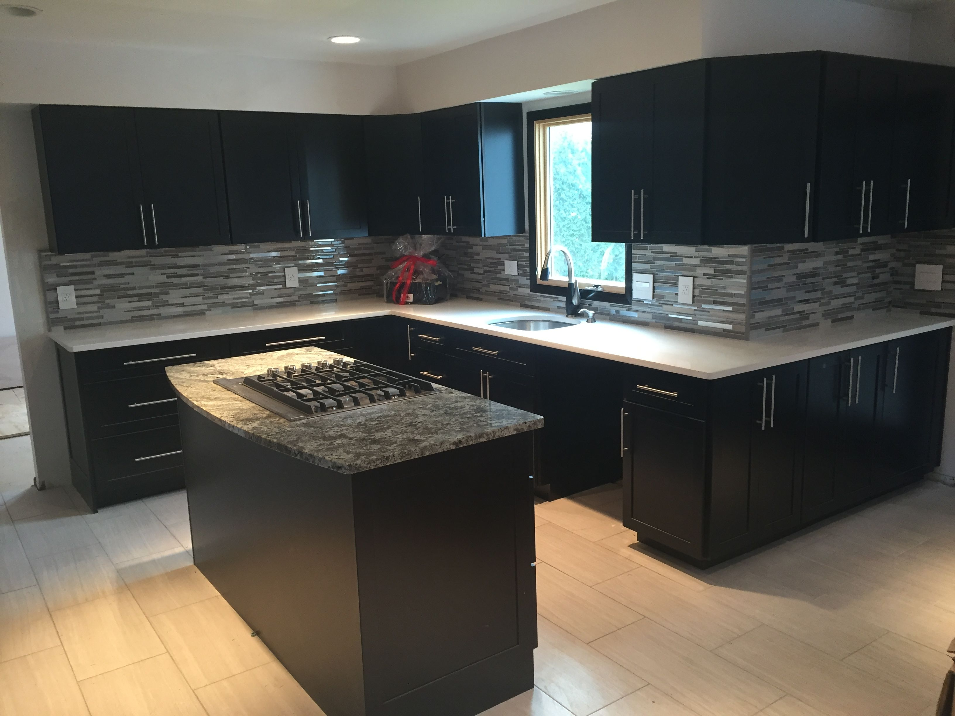 Modern Black And White Kitchen We Installed Ebony Kitchen Cabinets With Glass Mosaic T Kitchen Cabinets Makeover Glass Mosaic Tile Backsplash Kitchen Cabinets