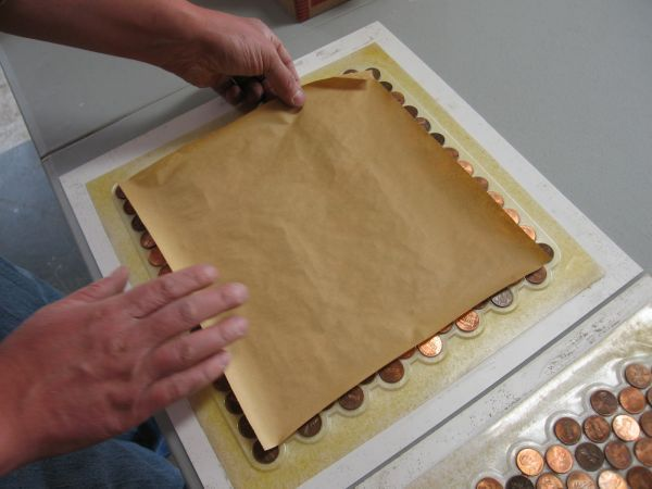 I finally realized what I can do with all those unwanted pennies..... --How To Make Copper Penny Flooring In 9 Easy Steps