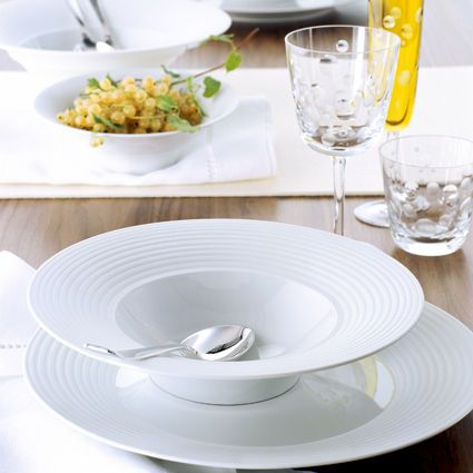 "Modern porcelain with a clear and poetic design is the hallmark of Hering Berlin's work. With the name ""Puls"", this entirely white table service is a celebration of pure form and is highlighted by its extra broad, grooved edges. These are made of rough, matt biscuit porcelain, which provides an exciting contrast to the otherwise translucent glazed crockery."