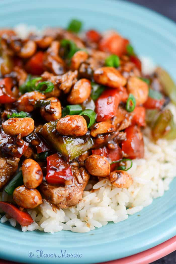 This Easy Kung Pao Chicken Recipeis a quick and easy Chinese inspired recipe that can be ready in less than 30 minutesand makes a great weeknight meal to celebrate Chinese New Year or for any time of year. #KungPao #KungPaoChicken #ChickenDinner #TakeOutFakeOut