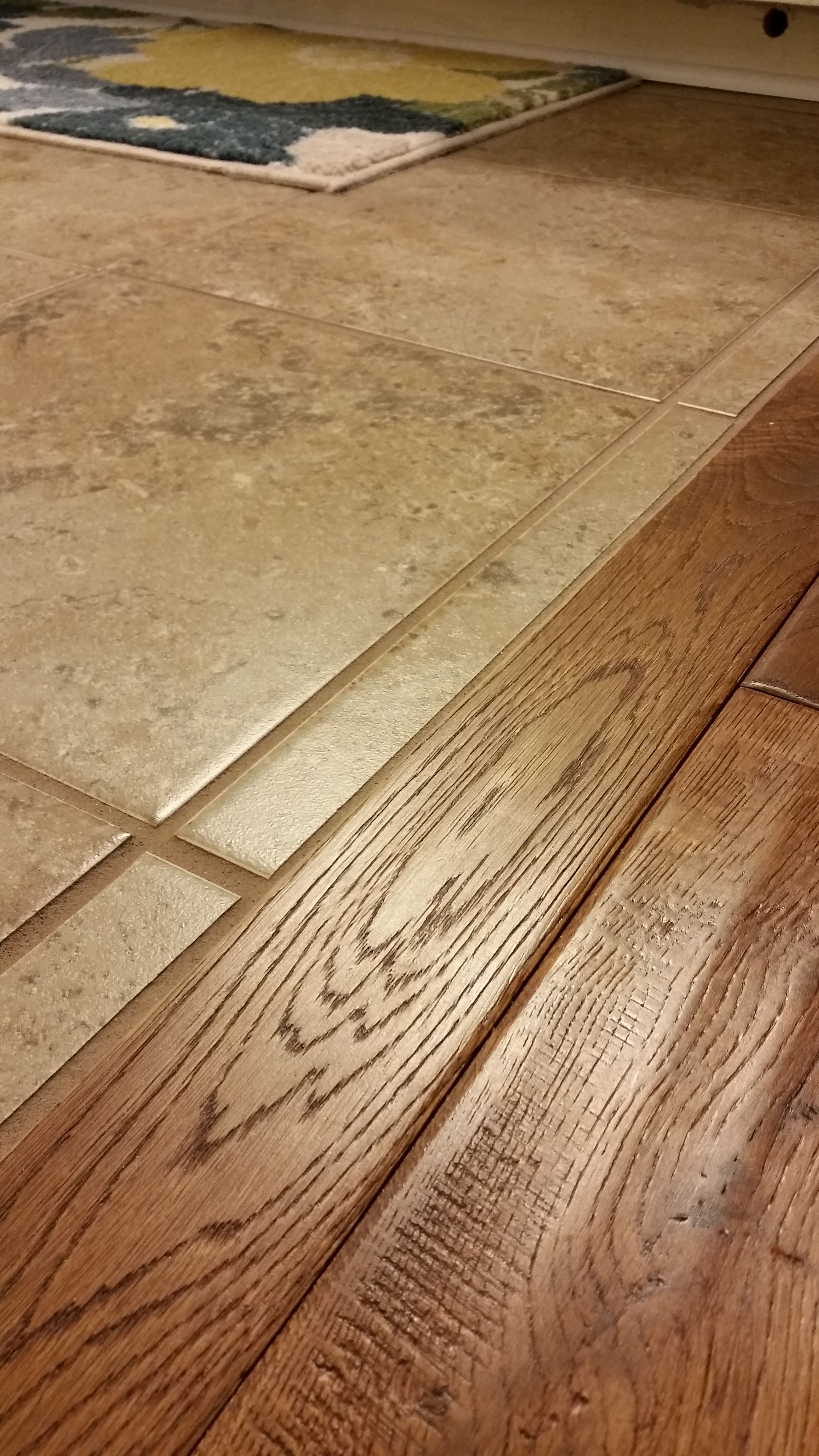 When wood and ceramic tile meet it is sweet without a for Ceramic laminate flooring