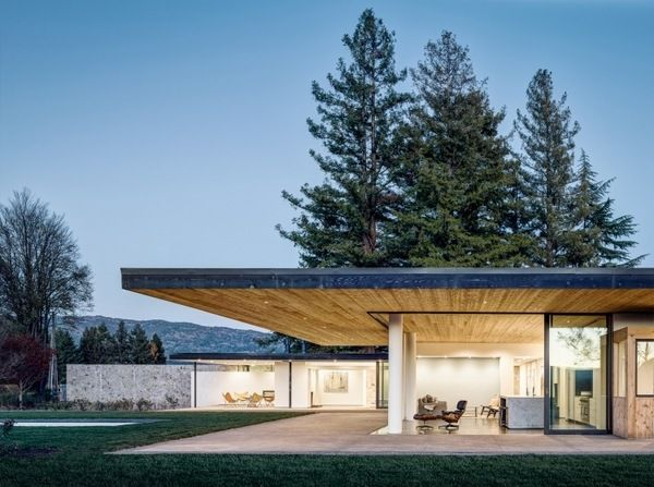 modern house architecutre flat roof cedar stone concrete deck