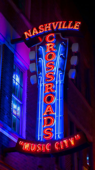 9a784000502fc Neon signs light up the night sky in downtown Nashville drawing ...