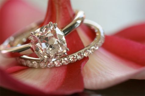 {Pave diamond eternity band with cushion cut diamond ring}