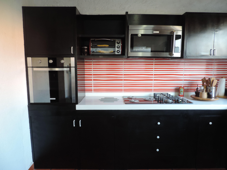 La cocina se rediseño para dar un ambiente más agradable y cálido ...