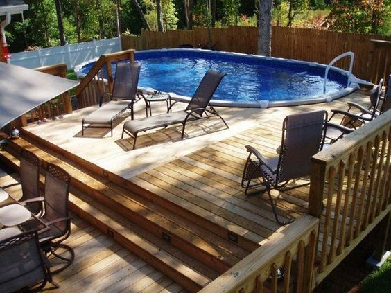Pool decks above ground pool deck oval swimming pool deck for Above ground pool decks for small yards