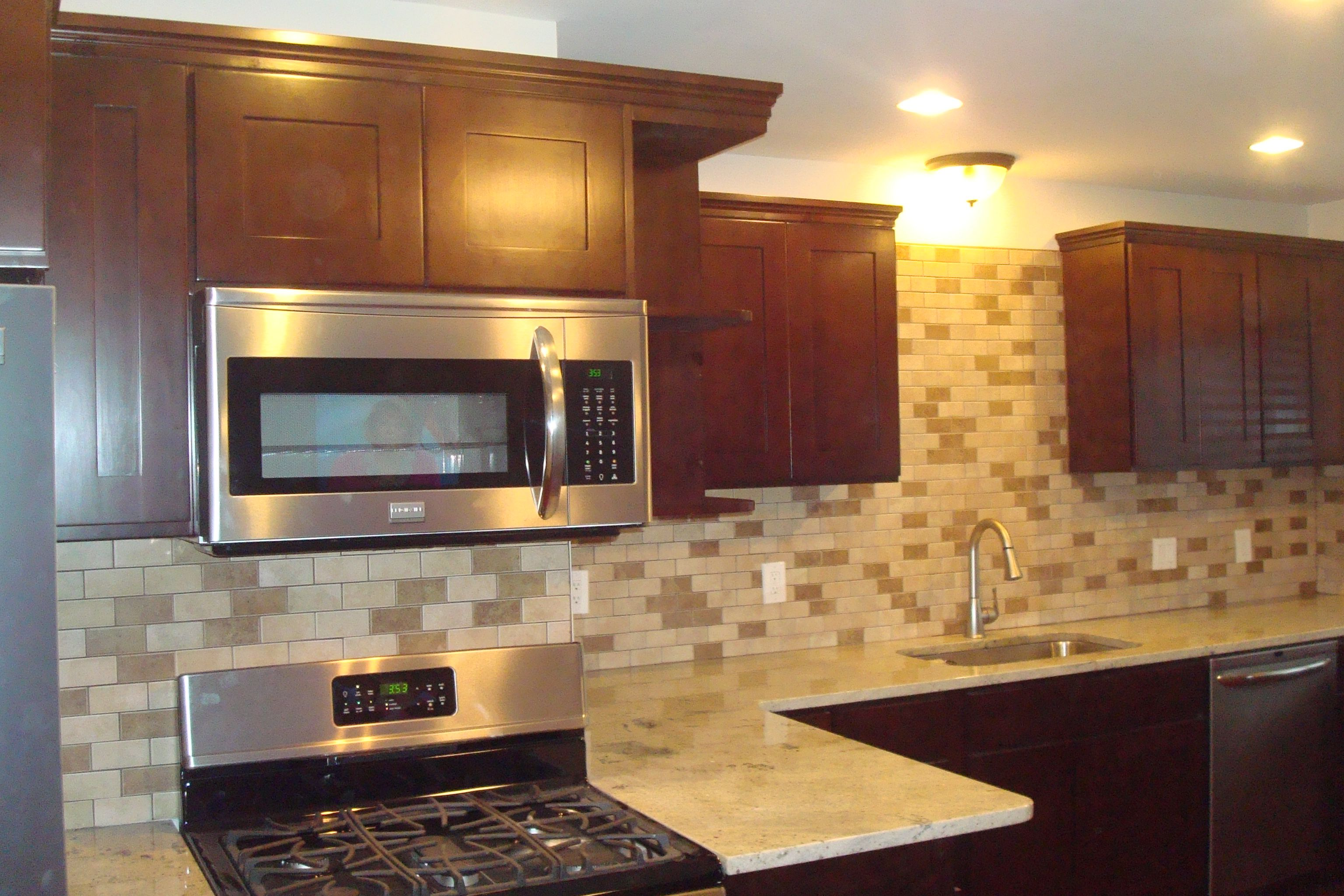 Expresso cabinets with solid wood doors and soft closing ...
