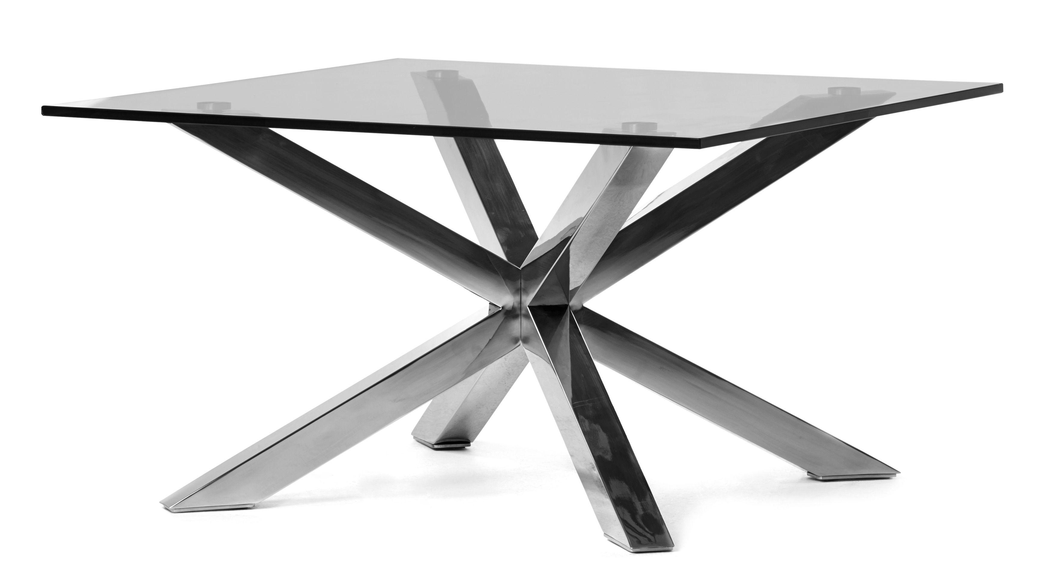 Modernt soffbord med kryssunderrede i lackad eller polerad metall och skiva av glas som ger en
