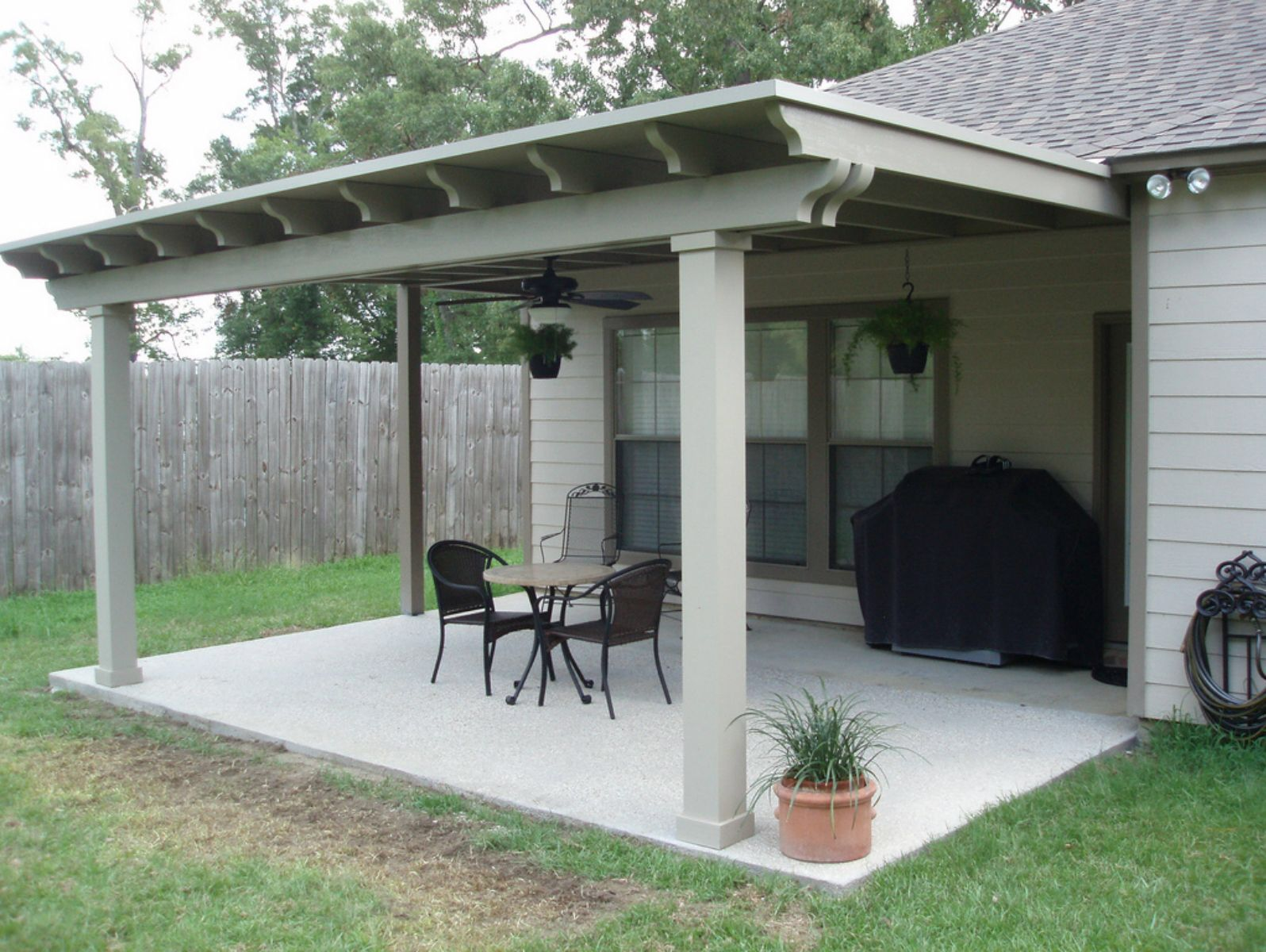 Enclosure Amazing Pergola Style Patio Cover And Wrought Iron Garden Hose Holder Also Black Ceiling Fan With Light Above Metal Base Round Table