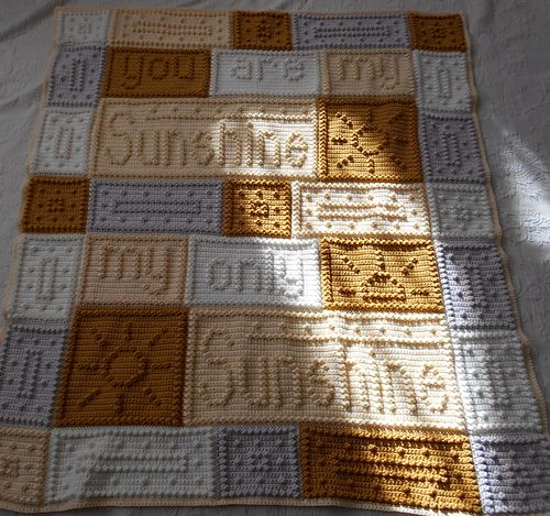 """This crocheted blanket is an original blanket design that is easy to complete. The blanket when finished reads, """"you are my sunshine my only sunshine."""""""