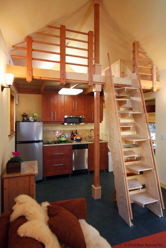 compact kitchen and alternating tread stairs in a 280 sq ft + loft cottage in Berkeley, California; built by New Avenue Homes