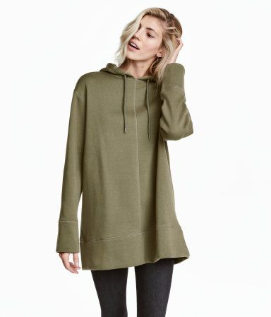 e6d01368d52c Khaki green. Oversized top with a lined drawstring hood. Dropped shoulders