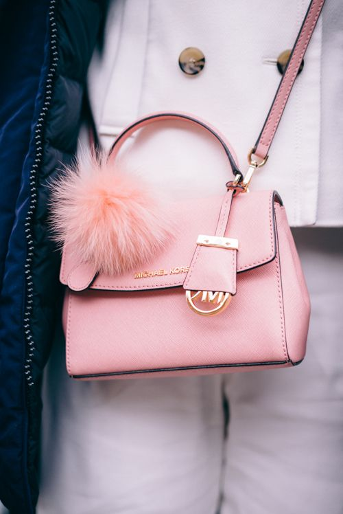 d5c65a73bd04d Winter in NYC - Michael Kors mini pink cross bag with fluffy pom pom
