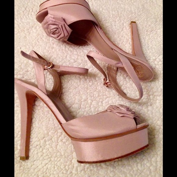 "Platform Flower Stilettos Such a feminine pair of high heels in a pale pink and raised platform. Single flower embellishment and rose gold ankle closures. Worn once!! 5"" heel 1 1/2"" platform Price Is Firm Vince Camuto Shoes Platforms"