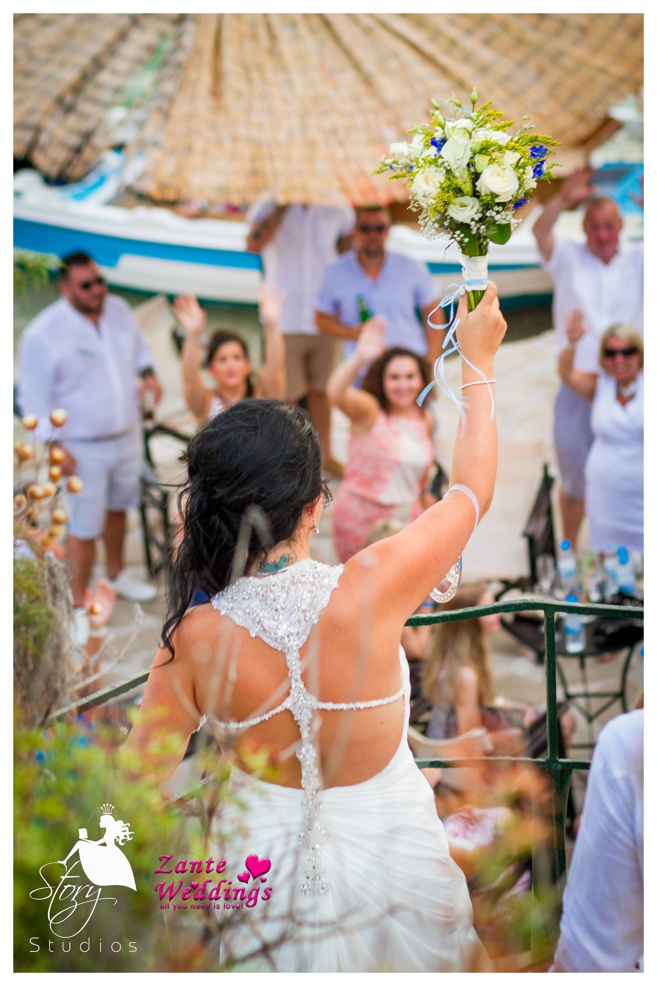 The bride preparing to through her bouquet