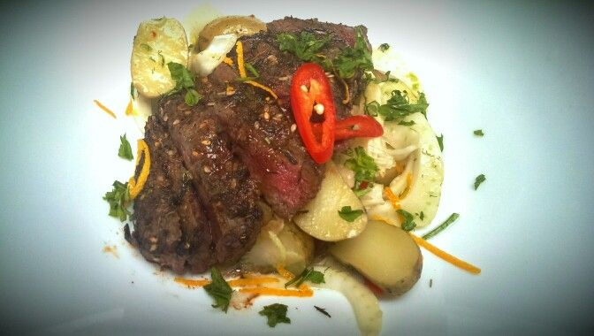 Fennel, potato salad with spicy citrus dressing and za'atar beef steak