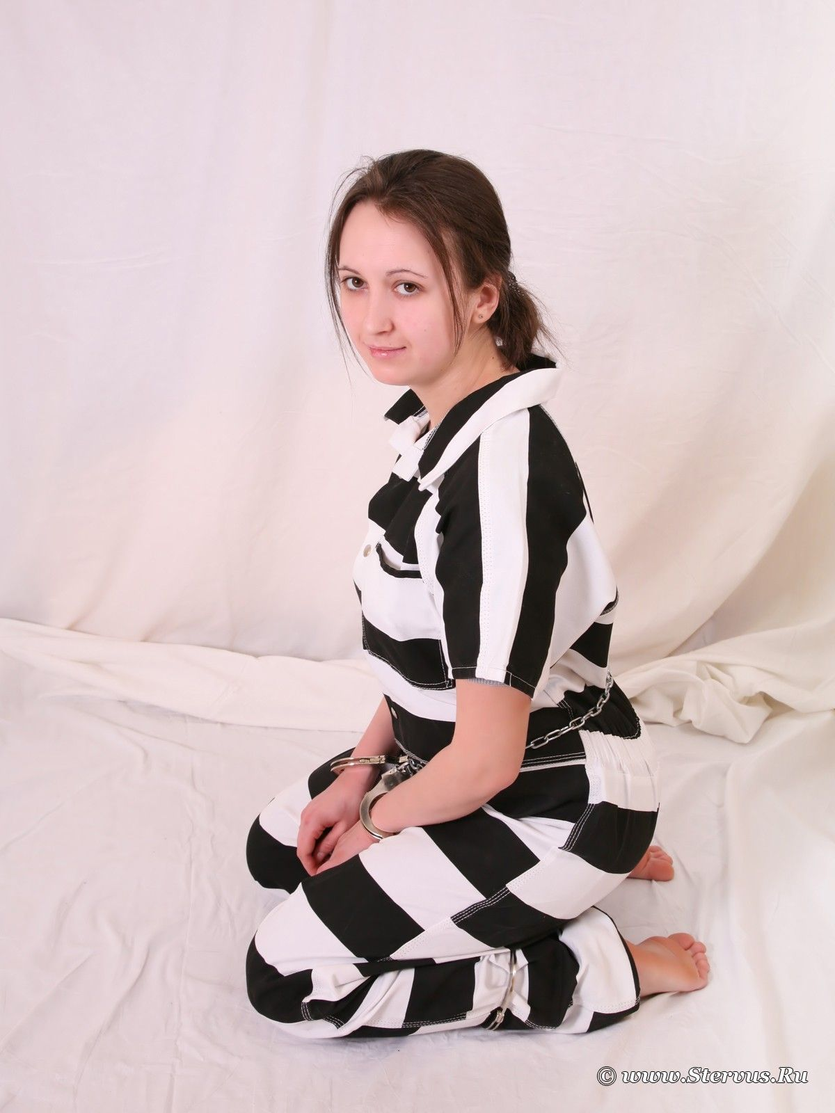 Woman Enjoys Prisoner' Game In Handcuffs And Leg