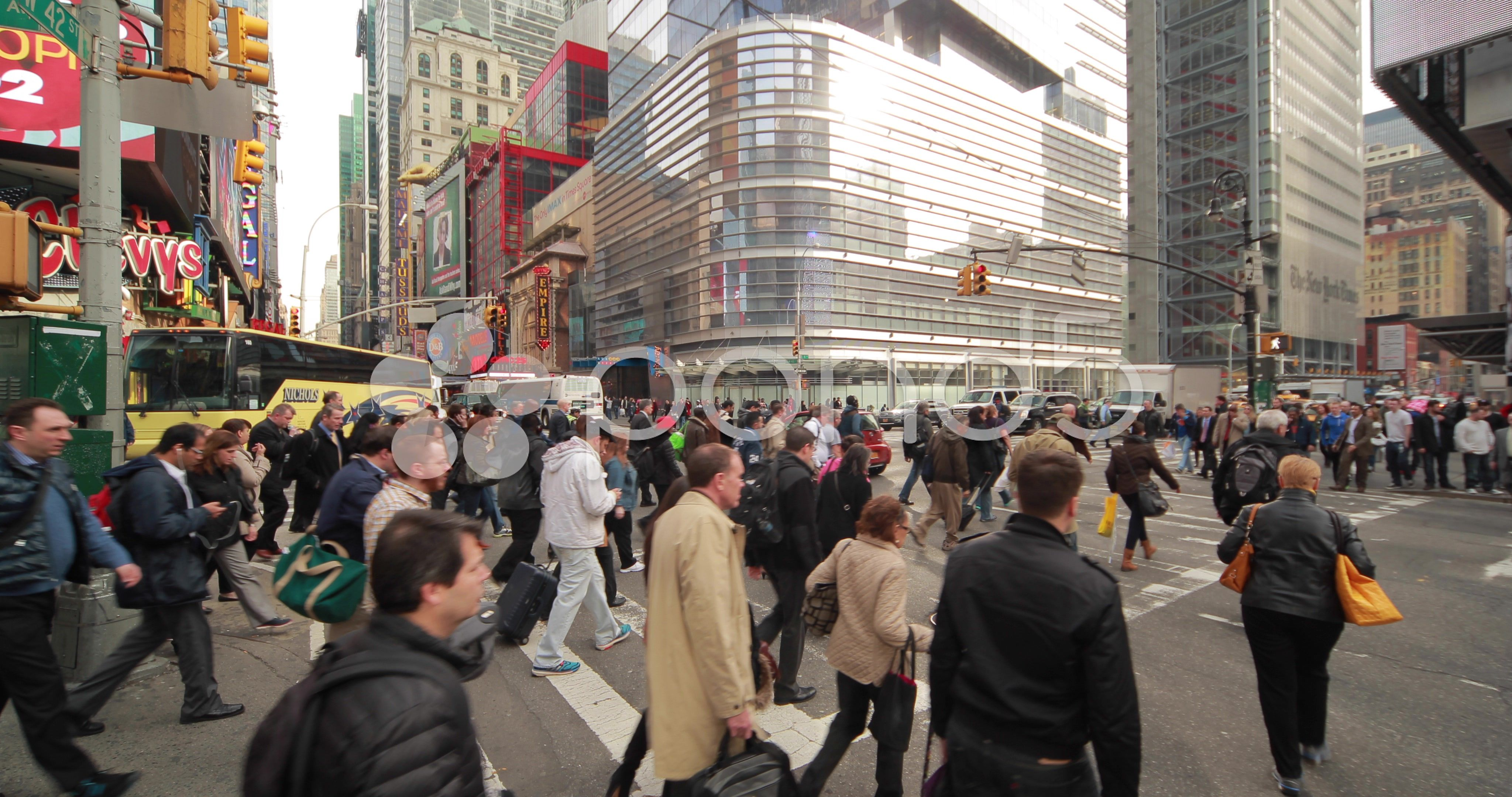 Crowd of people walking crossing intersection street time
