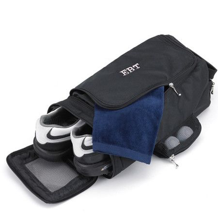 A perfect gift for the golfer in your life, this essential bag offers pockets for shoes, balls, towels, and more.  Product: Golf...