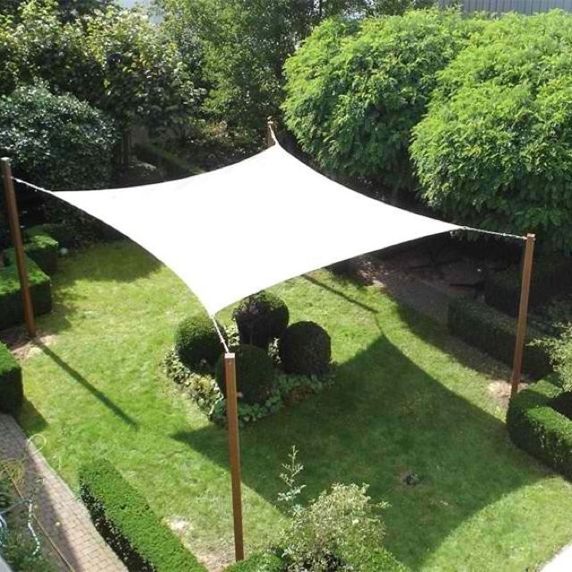 Need to get out of the sun a backyard canopy is a must for Garden decking canopy ideas