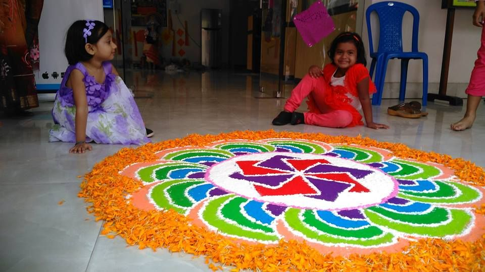 Happy faces in front of the beautiful Rangoli#NewYorkPublicSchool