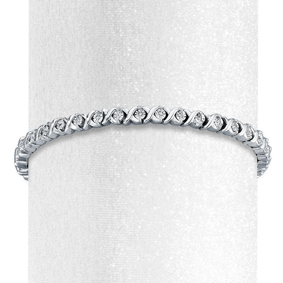 Sterling silver and brilliant round diamonds create picturesque style in this elegant 7.5-inch bracelet for her. Secured by a lobster clasp, this fine jewelry sterling silver bracelet has a total diamond weight of 1/3 carat. Diamond Total Carat Weight may range from .29 - .36 carats.