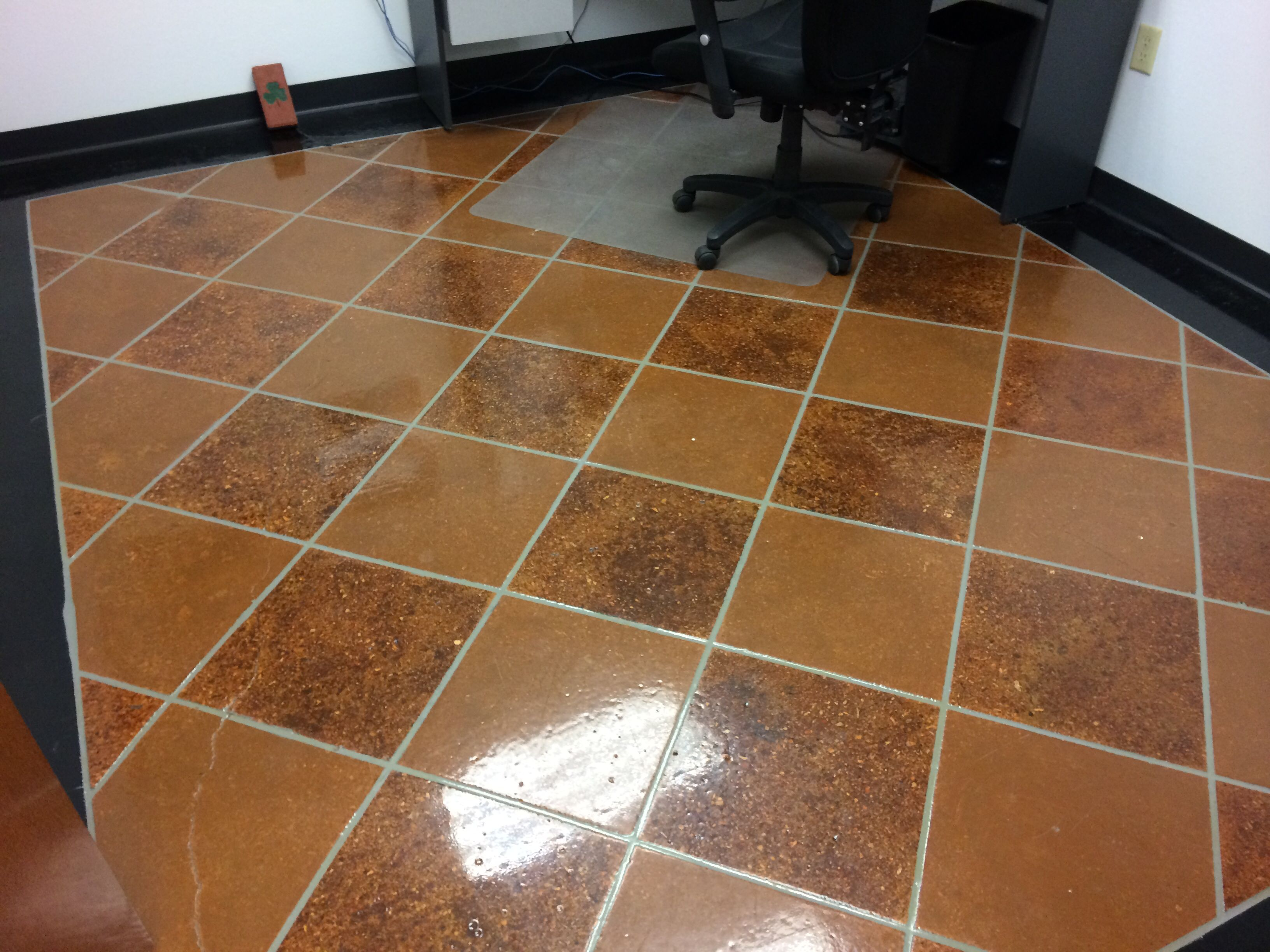Stained And Engraved Concrete Floor With Clear Coat Epoxy Finish