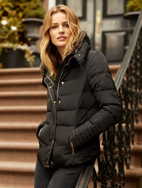 9137a3f332e0 Black gently-fitted down jacket. Stand-up collar with faux fur ...