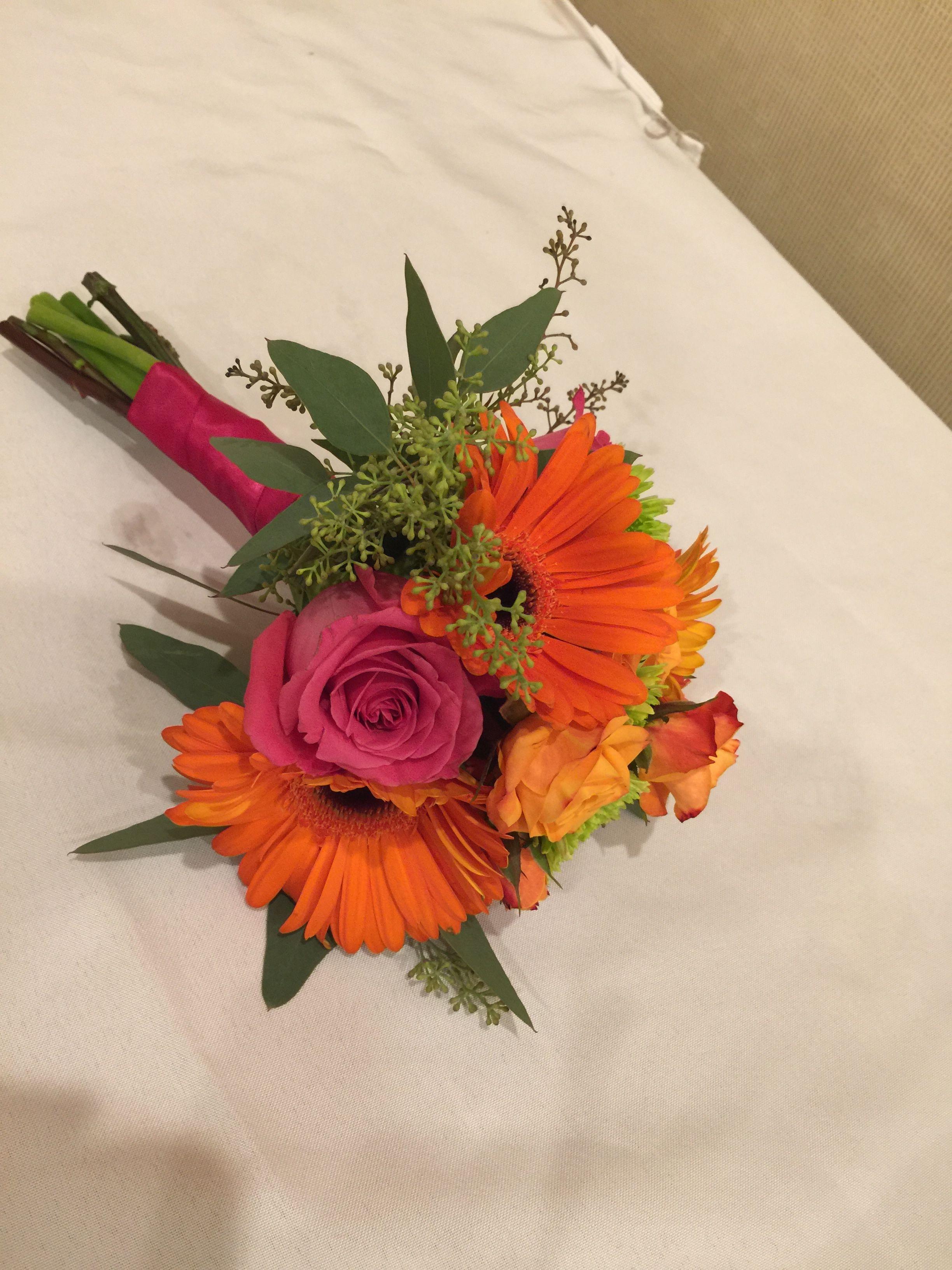 Bridesmaids bouquet orange and hot pink roses and gerbera