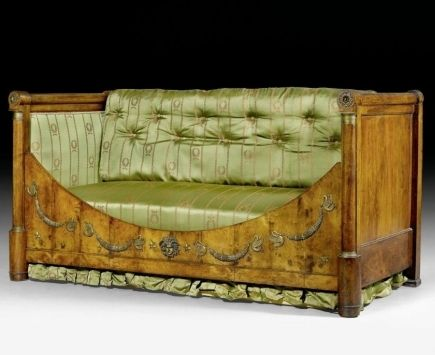 A Restauration period ormolu mounted mahogany daybed. Of rectangular form, with high back and sides featuring a carved semi-circular frieze to the front, mounted with ormolu swans, laurel wreaths and a mask, set on tapering baluster feet, upholstered in cushioned green and gold striped silk. French, c. 1830 Height 100cm, width 200cm. £7,500.00