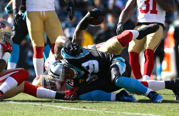 CHARLOTTE, NC - JANUARY 12: Steve Smith #89 of the Carolina Panthers is tackled after a catch by NaVorro Bowman #53 of the San Francisco 49ers in the first quarter during the NFC Divisional Playoff Game at Bank of America Stadium on January 12, 2014 in Charlotte, North Carolina. (Photo by Ronald Martinez/Getty Images)