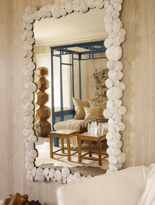love this mirror! im sure you could make one of these with shells from michaels and some hot glue! even could include sea glass