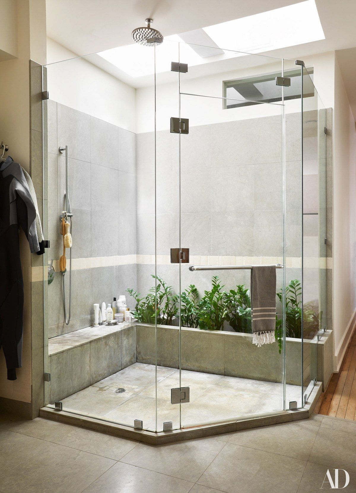A skylight in the master bathroom allows natural light to flood the ...