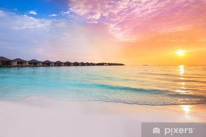 Beautiful sunset at tropical resort with overwater bungalows Wall Mural • Pixers® - We live to change