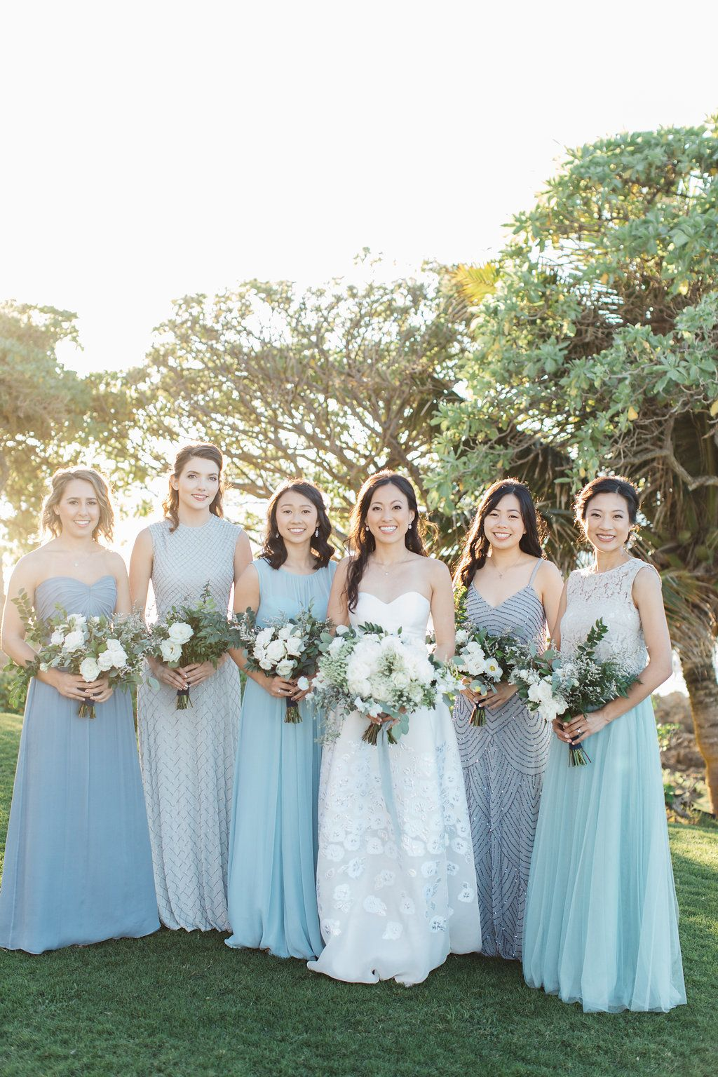 From Beautiful Blues To Sweet Slushies This Hawaiian Wedding Gets It Oh So Right Floral Bridesmaid Dresses Wedding Bridesmaid Dresses Hawaiian Wedding