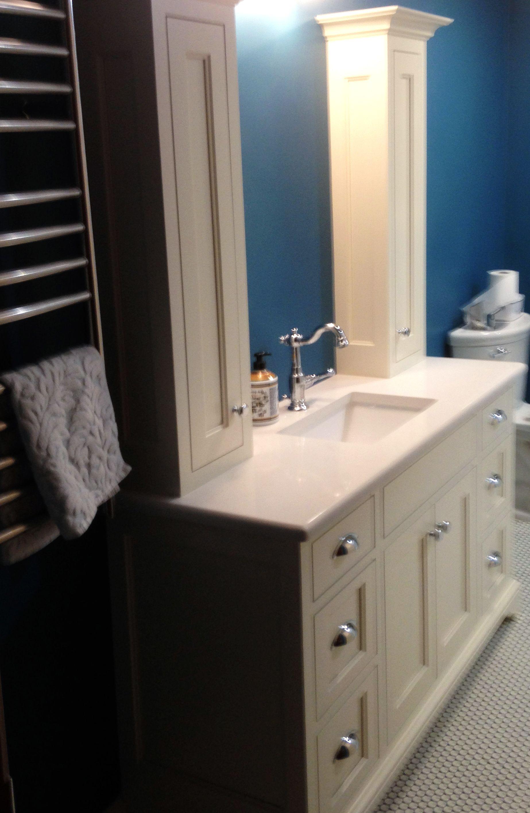 A Custom Built Bathroom Vanity With Small Vertical Storage