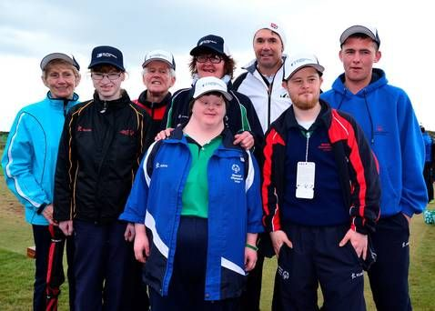 Padraig Harrington meeting members of Irelands special Olympic team at the driving range during the third round of the Dubai Duty Free Irish Open hosted by the Rory Foundation at Royal County Down Golf Club on May 30, 2015 in Newcastle, Northern Ireland. (Photo by Mark Runnacles/Getty Images)