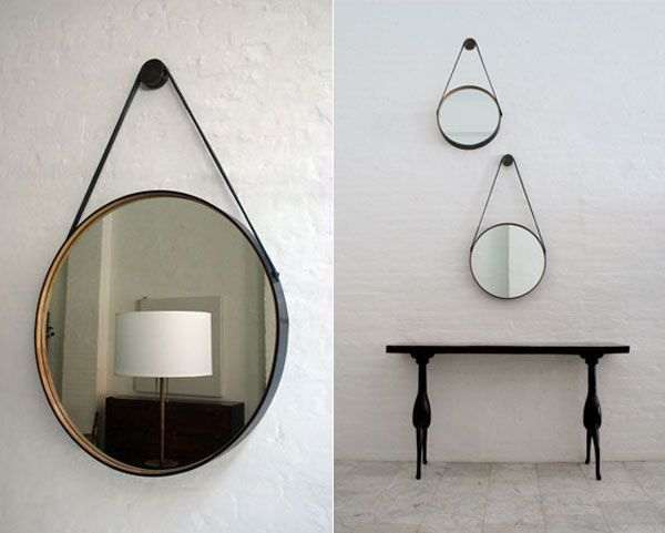 beautiful round mirror with a leather frame lined with wood by bddw furniture manufacturer