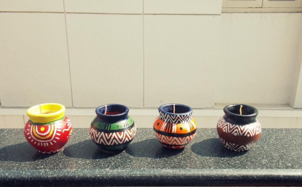Matki Candles! handmade candles in the traditional Indian matkis with Indian ethnic designs!