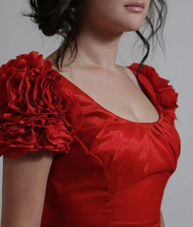 Ruffled rose sleeves - would look great on a dress, or maybe at the shoulders of a torera?