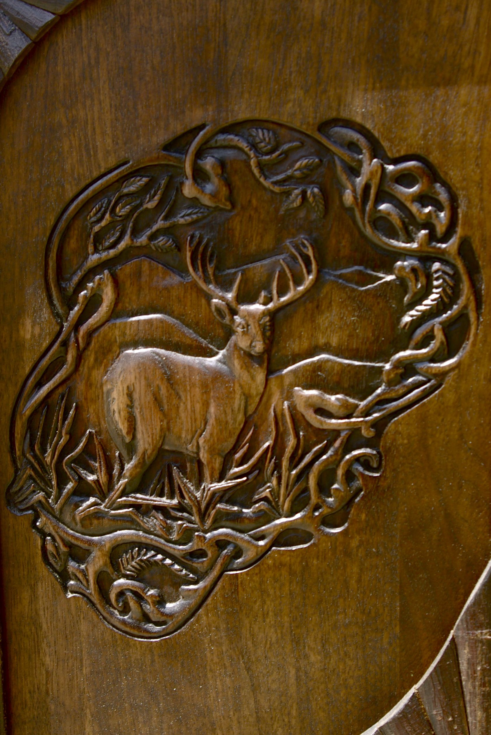Lpostrustics carving of buck on a credenza door bas