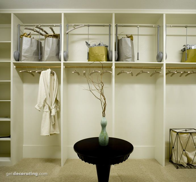 Check Out How The Top Closet Rods Lower To Ease Access.