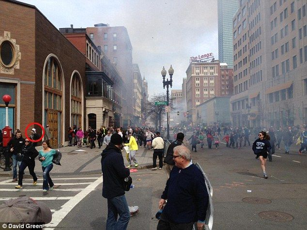 Dzhokhar Tsarnaev (circled in red) is seen making his way from the scene of the second detonation on Monday at the Boston marathon